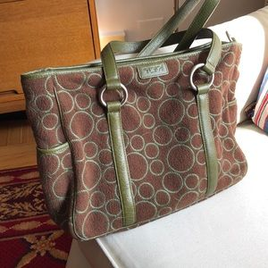 Tumi  shoulder tote with green leather trim.